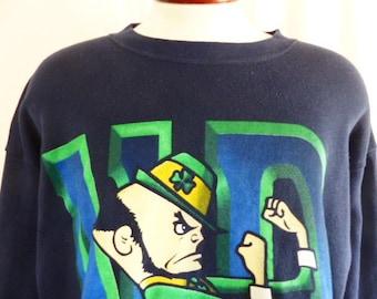 Go UND Fightin' Irish vintage 80's 90's University of Notre Dame navy blue fleece graphic sweatshirt yellow green mascot print crew neck XXL