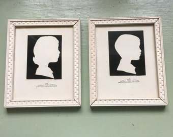 Vintage black and white silhouette boy and girl framed collectible pair collectibles
