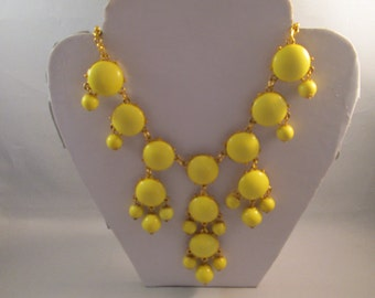 Bib Necklace with Yellow and Gold Tone Pendants on a Gold Tone Chain