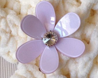 The plastic pale lavender colored flower magnetic scarf pin.