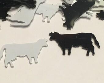 20 black and white cow confetti, 10 x 16 mm (2)