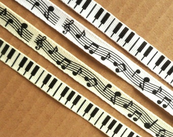 2 metres of Music themed ribbon, 10mm Grosgrain. Availible in either a musical notes, or a piano key theme, in white or cream