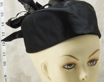 Renard black satin pillbox hat sold by Montaldos. Wired leaf adornments. 1960s