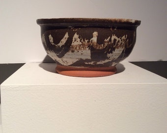 Fantastic 1970s brown and white glazed bowl with large glaze drip in interior