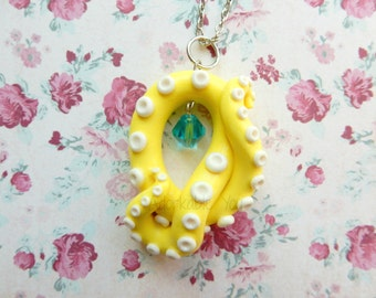 Pastel Yellow Tentacle with Hanging Blue Crystal