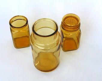 Retro yellow pharmaceutical glass jars