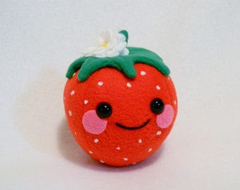 Plush strawberry toy with flower