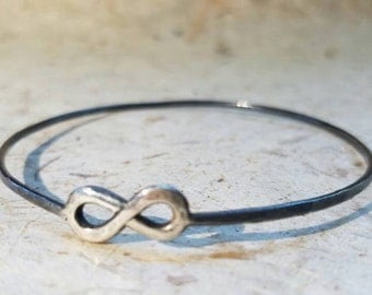 Hammered oxidized sterling silver infinity bangle