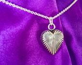 Anahata. Silver heart pendant.
