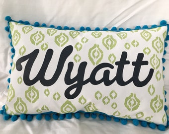 Pillow with green detail and name in dark slate grey