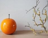 Ceramic orange sculpture, orange fruit in bright orange, earthenware clay orange with black, metal stem, Greek pottery orange