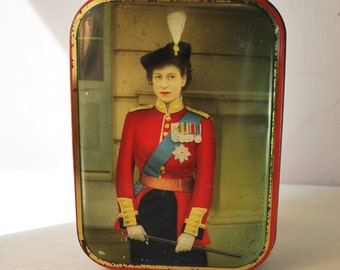 antique candy tin  Queen Elizabeth with WHIP in all of her glorious regalia made in england  classic candy tin antique candy box