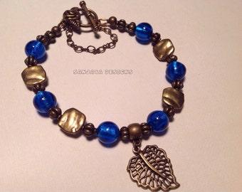 Bronze Cobalt Glass Beaded Bracelet .