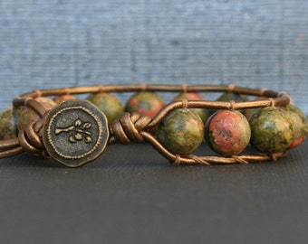 unakite bracelet - single wrap on bronze leather - bronze button - pink green beaded