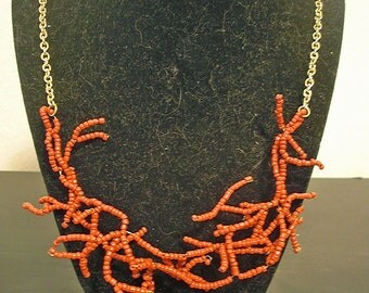 Golden beaded coral necklace