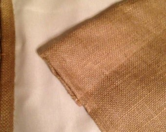 Lined burlap curtains.two panels  included