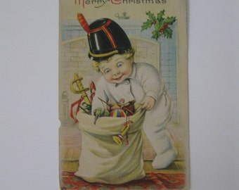 Christmas Holiday Vintage Post Card - Little Boy Goes Through Bag of Gifts with Excitement - Series 744C - Used - 1918