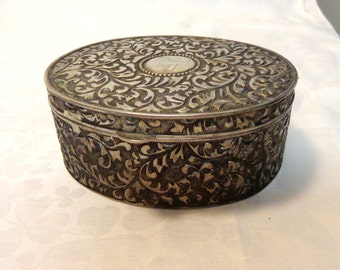 Repousse steel box hinged lid oval silvered interior for keys, jewelry, tea etc.