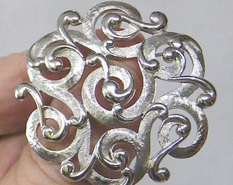 Vintage TRIFARI Silvertone Brooch Entwined Scroll Design