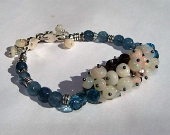 Ethiopian Opal Cluster Bracelet In Sterling Silver with Blue Topaz, Blue Apatite, and Mozambique Garnets