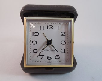 Vintage Westclox Portable Travel Alarm Clock Brown Closed Case Manual Wind Movement White Dial Black Numerals Acrylic Crystal Gold Metal