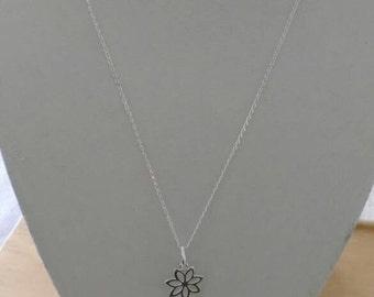 Sterling silver daisy and amber necklace