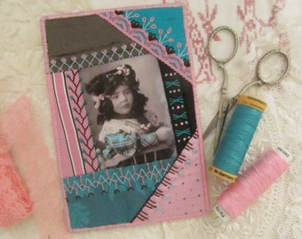 Crazy quilted fabric postcard with little girl in pink, turquoise and dark brown, handembroidered, great present for a quiltfriend