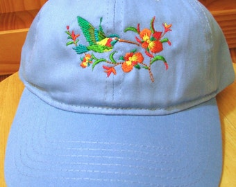 Hummingbird Embroidered on a Blue Baseball Cap.  Hummingbird and Flowers on a Baseball Cap
