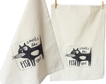 Smells like fish spirit. Tea towel, organic cotton. Screen printed by hand.