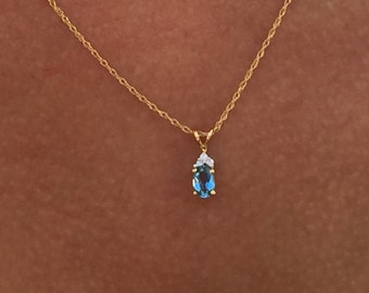 14k yellow gold blue topaz and diamond pendant and 18 inch rope chain