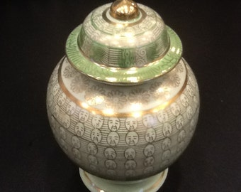 vintage urn with funny faces new old stock pastel green