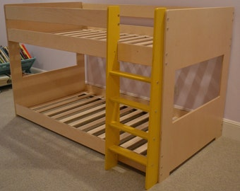 Mid bunk bed with yellow ladder