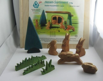 Original OSTHEIMER wooden figures / wood animals (marked). Wooden toys. Rabbit Assortment, 11 pieces, in original packaging. VINTAGE