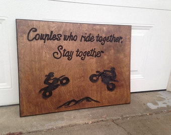 Couples who ride together, stay together carved sign.