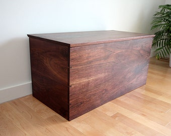 Dovetailed solid wood blanket chest in Black Walnut used for toys, storage, quilts, blankets, sweaters and more!