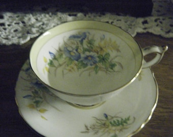 ANTIQUE PARAGON by appointment.  Fine Bone China.  England Regd.  Numbered Blue and yellow with gold trim very good condition.