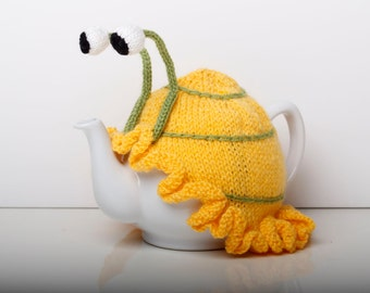 Knitting Pattern For Snail Tea Cosy : Knitted green snail tea cosy with frilly bottom. Washable fits