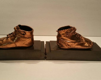 Vintage copper baby shoe bookends.