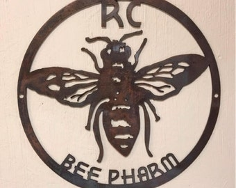 Custom metal sign with bee in bronze acid finish