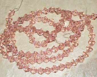 Faceted Clear Light Pink Glass Bicones - 6MM