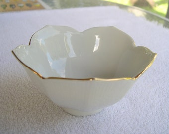 a vintage White Lotus Bowl with Gold Painted Accents