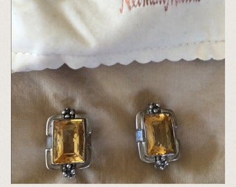 Sterling silver clip on earrings with yellow topaz stones