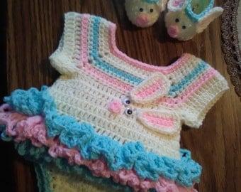 Newborn crochet onsie set.