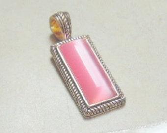 Polished natural pink quartz, rectangular pendant on .925 silver plate bezel