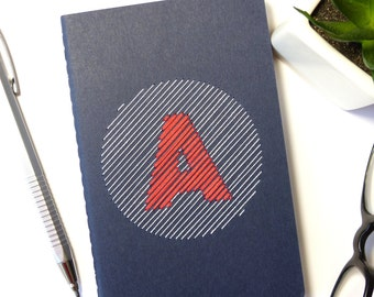 Notebook with white and red hand embroidered custom monogram-blue booklet-typography-writing-initial-graphic design-man woman and teen gift