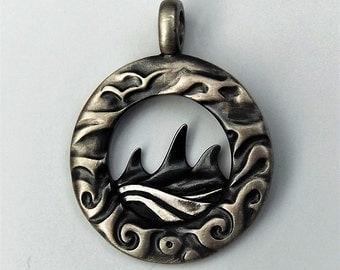 Silver Orca Family Portrait talisman necklace.