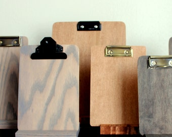 Clipboard stand,  for menu board, table numbers, or retail display. Clipboard sold separately.