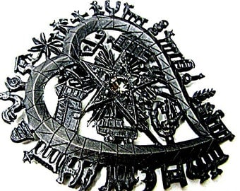 CHRISTIAN LACROIX brooch/pendant in blackened metal symbols surrounding