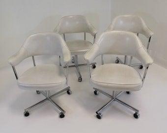 Vintage Mid Century Modern Set of Four Chrome White Leather Chairs on Wheels