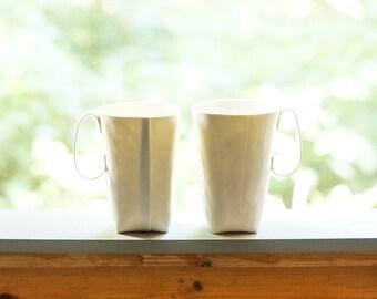 Medium folded mug, handmade from thin translucent porcelain, folded slab. Pottery, ceramics, cup.